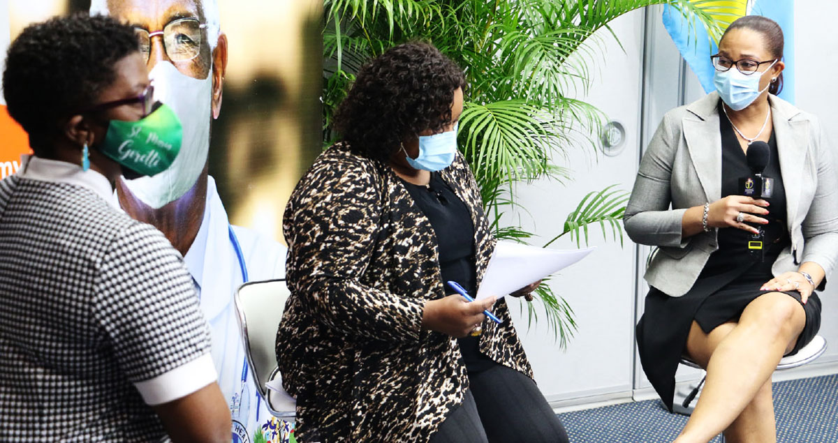 Image of CMO Dr. Belmar - George (r)speaks with Dr Merle Clarke (l) and Lissa Joseph about vaccine roll out.