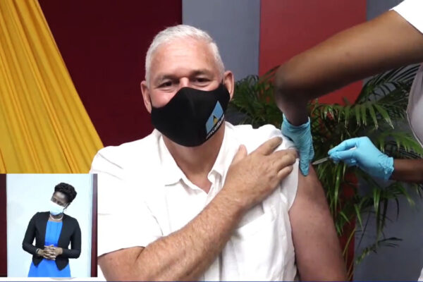 Image of Prime Minister Allen Chastanet receiving COVID-19 vaccine