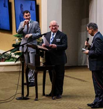 Image: Geoffrey Jackson (center), a member of the Governing Body, during the release program for the ASL Bible on February 15, 2020
