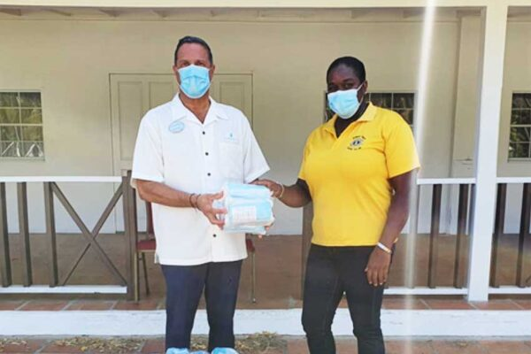 Image of Zone Chair receiving Donation of Masks.