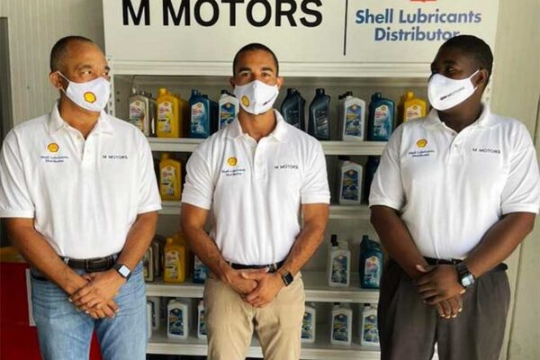 Image of Mario Reyes of M MOTORS, Simon Reyes, Director M Motors - Sales Executive for the SHELL product line, and Royden Edward, Parts Consultant at M MOTORS.