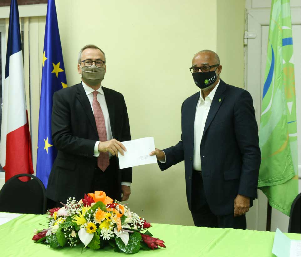 Image: H.E. Jacques-Henry Heuls presenting his Letters of Credence to Dr. Didacus Jules, Director General of the OECS