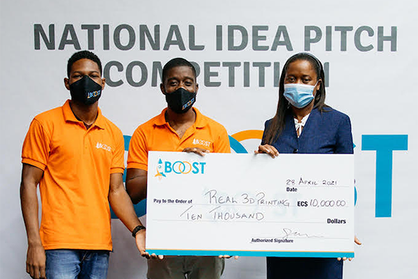 Image of Christan Tanner (far left) and Kayode James (centre) of Real 3D Printing were presented with the winning cheque for the National Idea Pitch Competition by Sophia Henry, permanent secretary in the Ministry of Commerce, International Trade, Investment, Enterprise Development and Consumer Affairs.