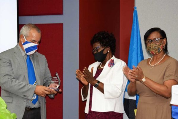 Image: Cuban Ambassador Marin (left) was thanked for his short tour of duty in Saint Lucia by former Governor General Dame PearletteLouisy (center) and HSA President Marlene Alexander