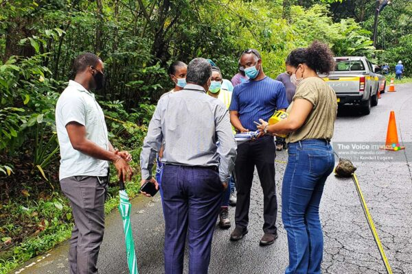 Image of Minister Joseph speaks with officials on road status