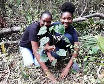 Image: [L-R] Sandals Foundation Ambassador, Samantha McPherson and teen volunteer Kayla Farquharson plant timber trees as part of conservation efforts to celebrate Earth Day 2019.