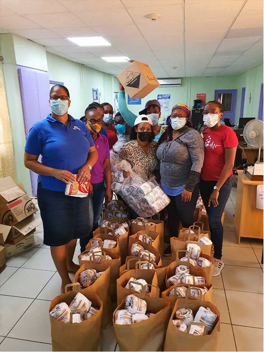 Image of Team Vincy with care packages for its members