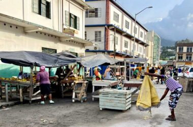 Image: Vendors at a market in Kingstown, St. Vincent begin to shake off the dust of the La Soufriere eruption. Photo Credit: Kenton Chance, iWitness News.