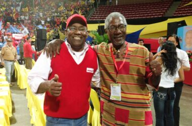 Image: AristobuloIstruiz (left) and Earl Bousquet at the Third Congress of the United Socialist party of Venezuela (PSUV) in 2017. (PHOTO: by Leiff Escalona)