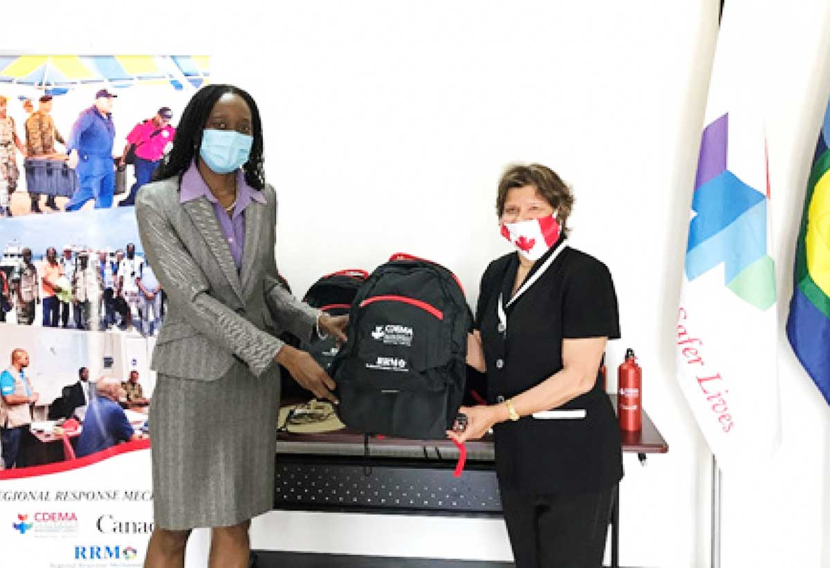 Image: CDEMA Executive Director (Ag.) Elizabeth Riley (left) receives a Deployment Package from the High Commissioner to Canada, Lilian Chatterjee