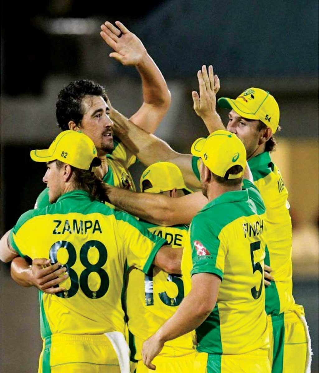 Image: Australia celebrate clinching victory. (Photo: AFP/GI)