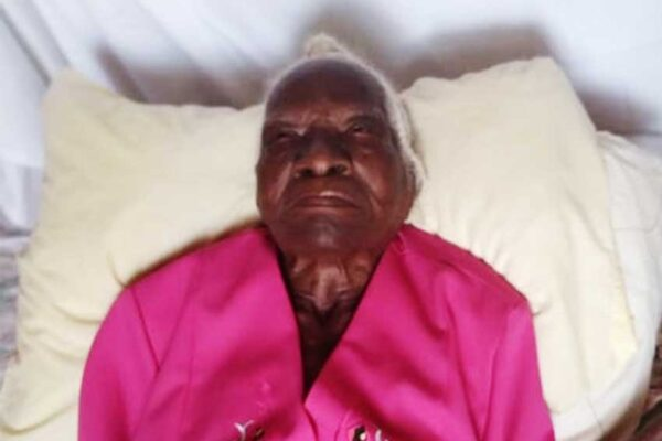 Centenarian Cyrillia Nervais lying in bed