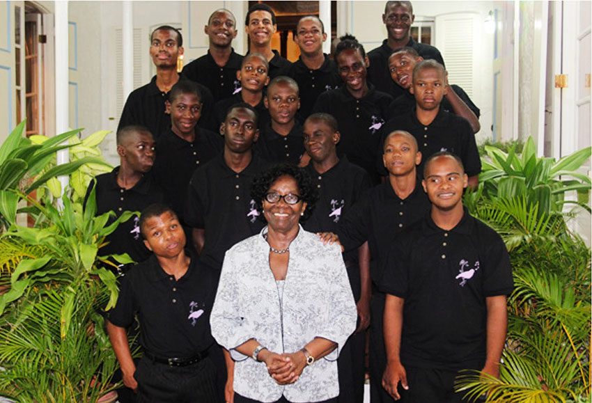 Dame Pearlette Louisy with the band members from the Dunnottar School and the Boys Training Centre.