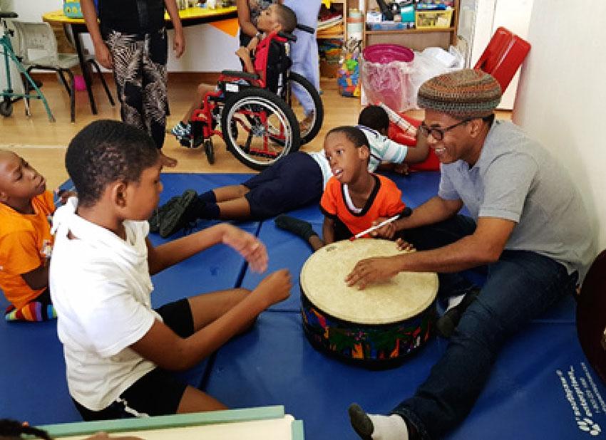 Music teacher John Polius and students.