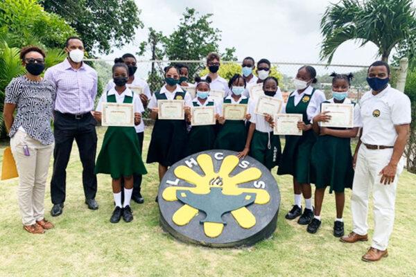 Photo moment for Resident Instructor, Sensei Kara - Lee Emmanuel -Theobalds, Sensei Karim Sifflet, students and LHCSS Principal, Rohan Lubon. (Photo: SKIF Saint Lucia)