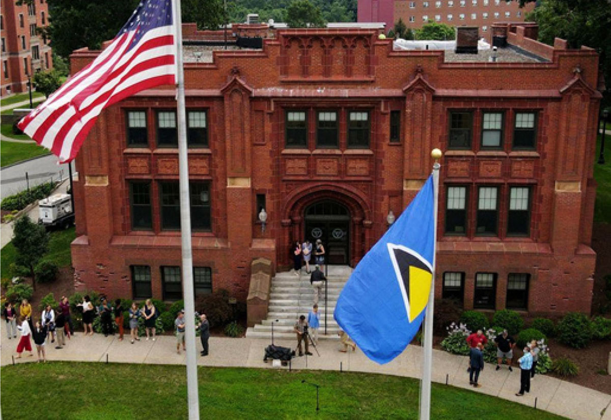 The Saint Lucia National Flag alongside the USA National Flag at Springfield College on Alden Street. (Photo: SFC)