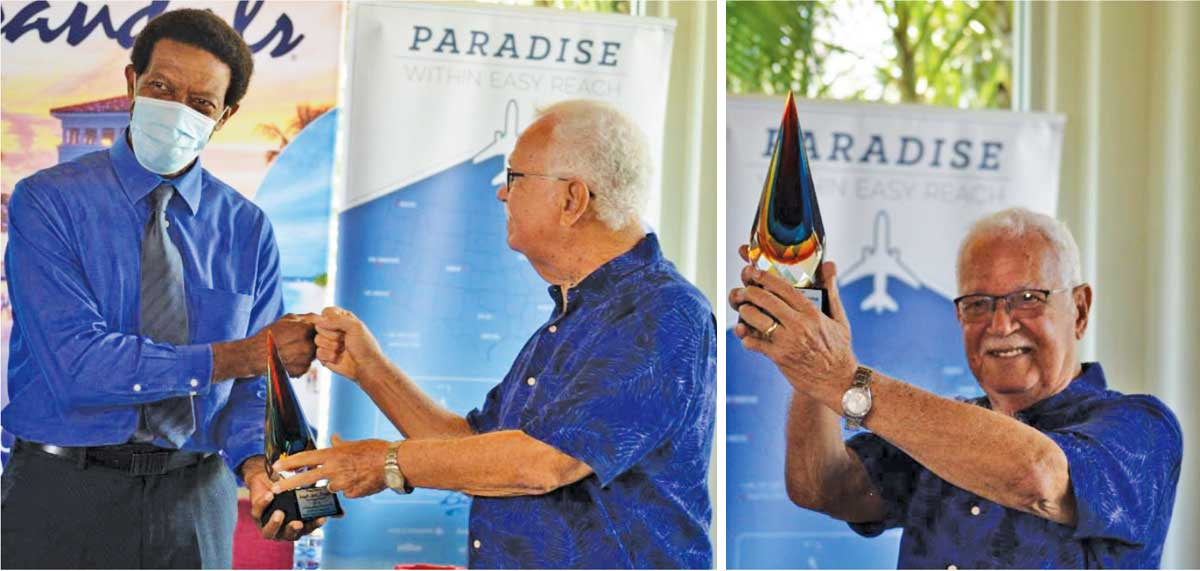 President of Saint Lucia National Cricket Association, Carol Henry presenting Perreira with a token; 'Reds' 50 and counting. (Photo: Anthony De Beauville)