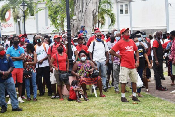 Crowd outside parliament building watching the swearing in of cabinet ministers Thursday.