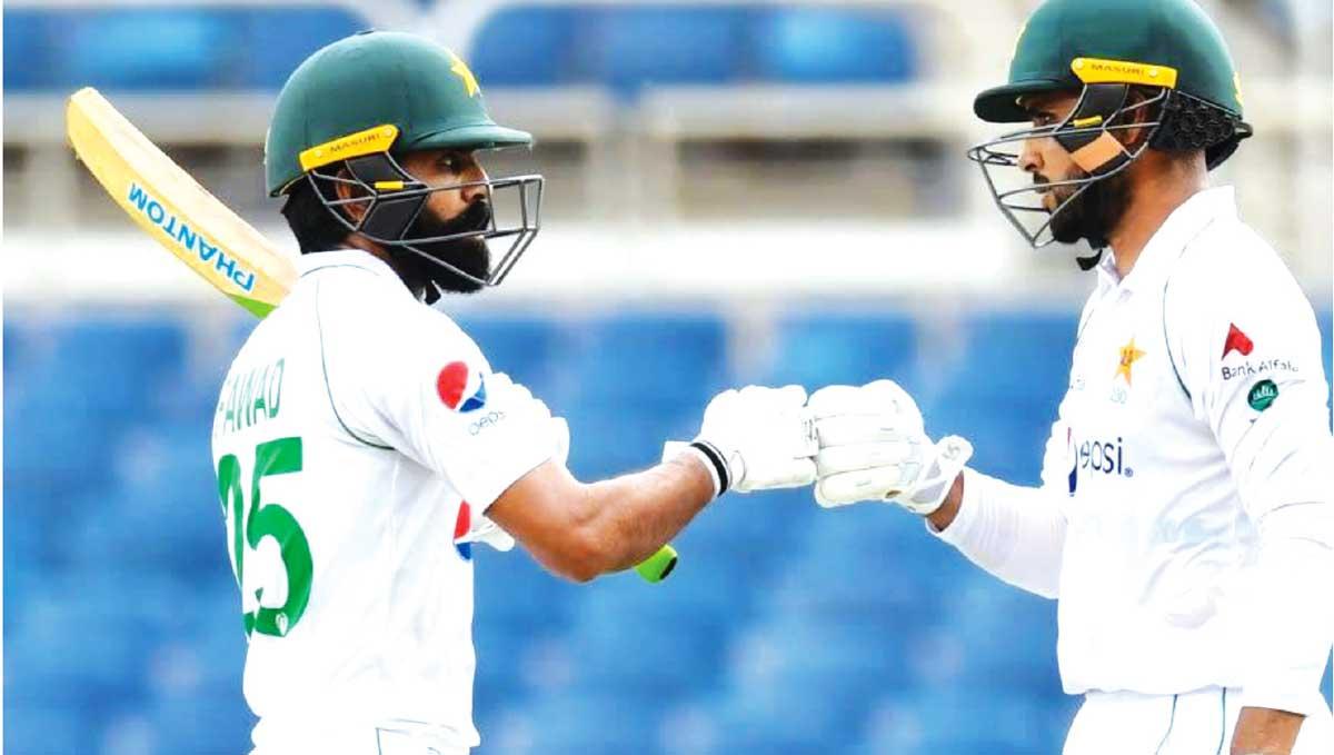 (L-R) Pakistan No. 5 Fawad Alam (56) and No. 7 Faheem Ashraf (44) shared a half century stand. (AFP/GI)