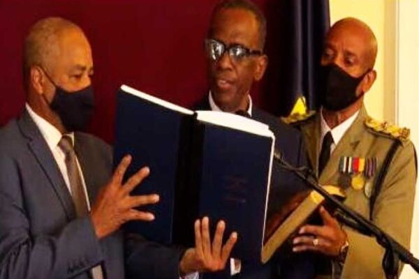 Prime Minister Phillip J. Pierre (centre) being sworn into office.