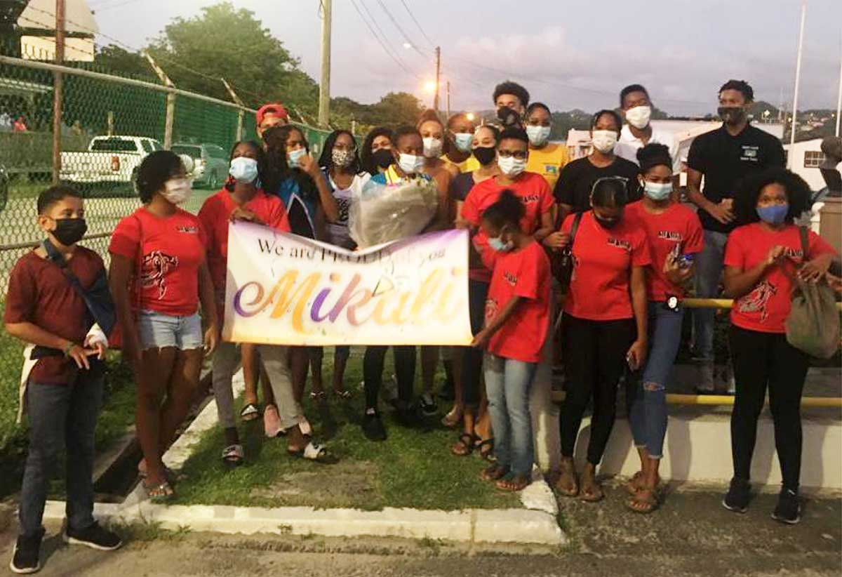 Sharks Swim Club came out in the numbers to welcome their club member and Olympian Mikaili Charlemagne. (Photo: SLAF)