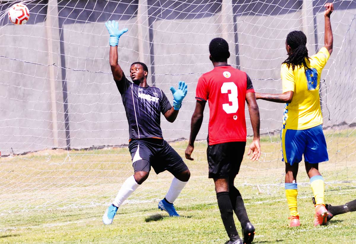 PFC's prolific striker Antonio Joseph gets one past MFC goalkeeper.