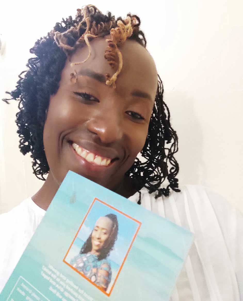 A smiling Emlynn Francis showing off her book.