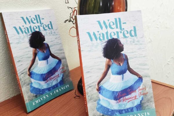 """Two copies of """"Well-watered"""", a novel by Emlynn Francis"""