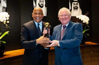 Hon. Dr. Ernest Hilaire — Minister for Tourism receiving award from Graham Cooke, Founder & President of World Travel Awards