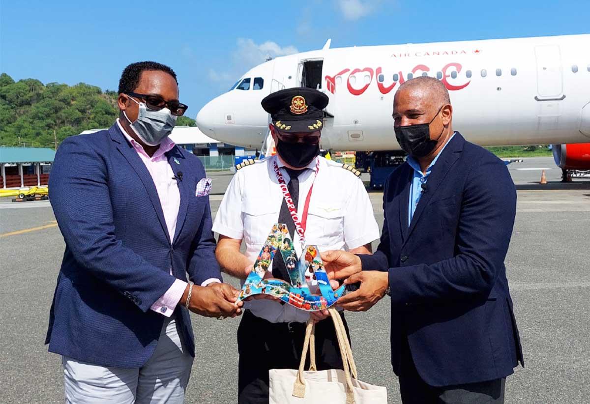 Tourism officials presenting to captain Christopher Clarke a commemorative plaque.