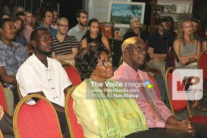 Governor General Dame Pearlette Louisy and CDF Executive Director Melchoir Henry absorbed in Kincaid's lecture.