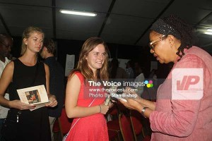 Visiting American university students  get their copies of Kincaid's books signed by the author.