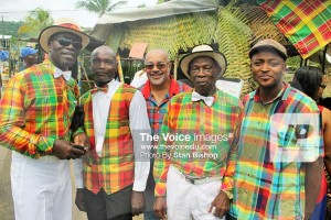 "OECS Director-General, Dr.Didacus Jules, (centre), seems to fit right in with the band. At least ""threads-wise""."