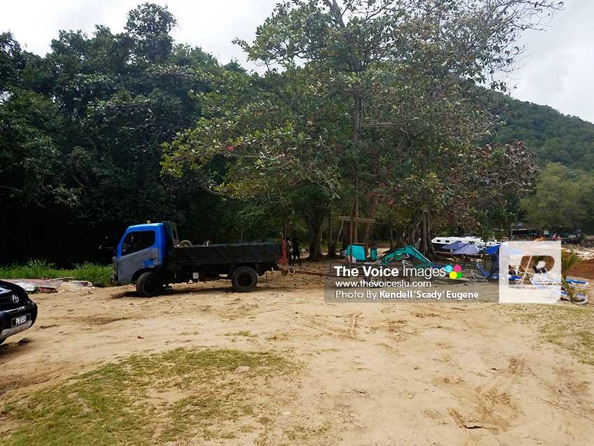 Dump Truck waiting on Sargassum
