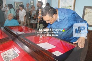 Prime Minister Dr. Kenny Anthony gets a closer look at some of the displays. [PHOTO: Stan Bishop]