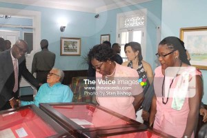Dame Pearlette Louisy examines some of the historic documents on display in Walcott House. [PHOTO: Stan Bishop]
