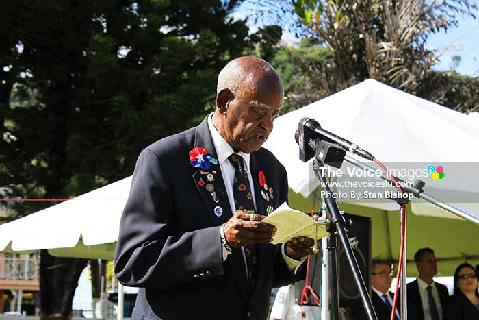 Secretary of the Ex-Service League, Earl Francis, reads the names of the Saint Lucians who died in battle in World War II.